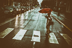 Red Umbrella (Claus Tom) Tags: street red woman color cars colors car rain weather female umbrella copenhagen denmark women candid streetphotography automotive faded rainy transportation crossprocessing cph toned climate kbenhavn toning