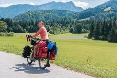 Arriving to the border with Slovenia over a cycling path (TheCrazyTravel.com) Tags: road travel italy woman mountains alps green girl field bicycle cycling italia cyclist path border roadtrip it slovenia traveling touring latvian touristic biketouring panniers ilze tarvisio friuliveneciajulia