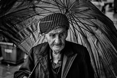 Man wiht umbrella (Saman A. Ali) Tags: street streetphotography stphotografia blackwhite blackandwhite monochrome photography people portrait man