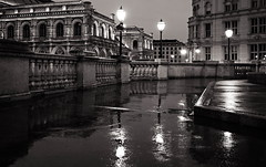 Rainy Evening in Vienna, Austria (Regina Gavrilov) Tags: photography travels travel digital canon lonelyplanet blackandwhite monochrome streetphotography lights rain sidewalk urbanphoto blackwhite bandw noir white blanc scene street photographer life streetphotographer foreign composition