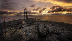 At the lighthouse (Mark Holtslag) Tags: norway haugesund lighthouse sea shore sunset sky clouds water seascape