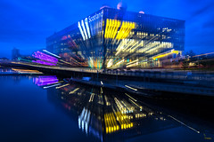 A twist of the zoom ring (Waving lights in the dark) Tags: zoom zoompull zoompulling glasgow scotland riverclyde clyde river reflection reflections water bluehour dusk different walkabout night nightphotography trying pull wavinglightsinthedark quayside bbc modern modernarchitecture