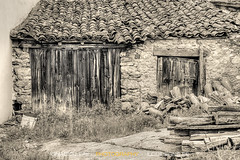 Time goes by (ILO DESIGNS) Tags: madrid door old house monochrome architecture facade rural wooden spain europe village time outdoor stones decay traditional creative