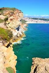 cliffs of Nazar (ekelly80) Tags: portugal nazar june2016 summer cliffs water ocean atlanticocean clear leiria view scenery beautiful blue sand beach rocks below lookdown