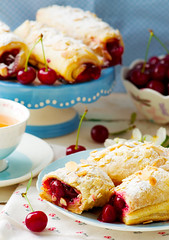 Pies from puff pastry with cherry (Zoryanchik) Tags: red food cake closeup fruit breakfast cherry pie crust dessert sweet puff tasty fresh sugar crisp homemade snack almonds pastry jam pastries filling freshness baked stylevintage