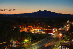 In The Shadow Of Heart Mountain (wyojones) Tags: cody wyoming heartmountain 8thstreet mountain twilight hotel campground restaurants lights buildings