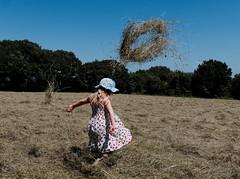 # 10 ring of hay (watcher330) Tags: girl hay air field