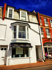 other criteria, Ilfracombe, North Devon (photphobia) Tags: ilfracombe northdevon uk seaside victorian victorianresort holiday sky oldwivestale outdoor perspective vanishingpoint road buildings building buildingsarebeautiful architecture houses shops hotel victorianterrace othercriteria damienhirst shop