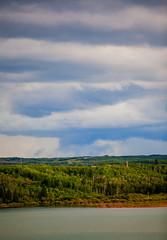 Cloudy with a Chance of Rain (stevenbulman44) Tags: 70200f28l canon summer cloud storm weather landscape rain lines resevoir calgary alberta