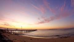 The light of a new day (Howard Ferrier) Tags: oceania victoria pointlonsdale sunrise pier dawn heads marinestructures clouds beach people inlet water sand bay jetty australia portphillipbay bellarinepeninsula au time elements materials architecture
