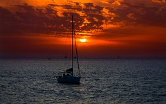 sailing at sunset - Tel-Aviv beach (Lior. L) Tags: sunset sky beach silhouette clouds sailboat telaviv sailing sail sailingatsunsettelavivbeach