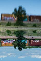 200/366 - All Tapsalteerie (sdgiere) Tags: railroad reflection graffiti iowa symmetry inversion dubuque tapsalteerie