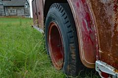Deflated Situation (BKHagar *Kim*) Tags: red wheel truck vintage cabin rust flat antique background rusty tire firetruck logcabin rusted vehicle fireengine limestonefleamarket bkhagar