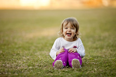 little girl playing in grass, laughing (Tonya B4) Tags: girl toddler room space copy outside outdoor sunny cute beautiful green caucasian one person pink smile shallow depth focus play fun lifestyle life horizontal grass field lawn full length attractive adorable baby bright cheerful child childhood happy leisure preschooler pretty summer spring goofy laugh learn warm sit unitedstatesofamerica