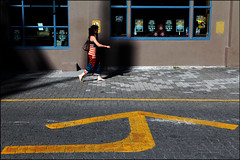 Arrow (HereInVancouver) Tags: youngwoman strollingby walking sidewalk trafficarrow stripeddress colors canon granvilleisland vancouver bc canada outdoors candid streetphotography