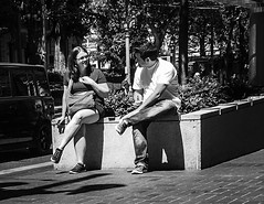The Good Talk (TMimages PDX) Tags: iphoneography photography image photo photograph streetscene fineartphotography geotagged people urban city street streetphotography portland pacificnorthwest sidewalk pedestrians buildings avenue road blackandwhite monochrome vignette friends man woman