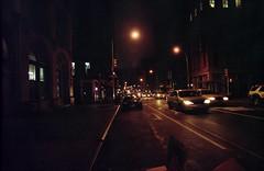 Broadway (tomlangley) Tags: street new york nyc urban slr cars film night 35mm dark lights traffic grain broadway 24mm