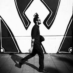 'W' is for walking... (shotbywiles) Tags: street shadow sunlight streetart art st bristol walking graffiti artist pavement stpauls streetphotography pauls sidewalk streetartist fujifilm strolling streetphotographer heavyshadow xpro1 ukstreetphotography wisforwalking xf18mm wilesphotographer wilesphotography wilesstreetphotographer ukstreetphotographer wilesstreetphotography