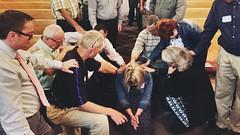 Praying over a prayer leader, Mary Sternberg.