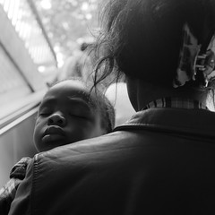In the arms of our mothers (gambajo) Tags: street people blackandwhite baby black relax blackwhite kid child sleep mother streetphotography sleepy mum relaxation