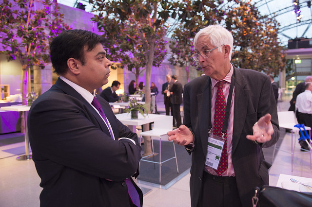 Pravin Krishna and Anthony May discussing