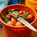 A bucket of Tomatoes and Greens