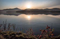 Just as the Sun Rises - Lake Placid (SAFIRE PHOTO Sam Firestone) Tags: safire safirephoto nikon nikon810 landscape water wide wideangle trees sky sunset sunrise sun photo photography color colour scene scenic reflection mist lake coast serene lakeplacid morning