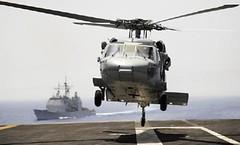 100616-N-7317W-009 (Nelson Dillehunt) Tags: usn ussnormandycg60 ussharrystrumancvn75 mediterraneansea shiptypes surfaceships aircraftcarriers cvn ships helicopter sh60 seahawk flightdeck vertrep supply navy usnavy