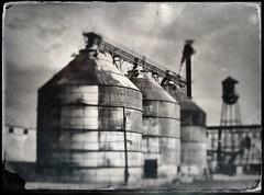 Silo Group Tintype (Neal3K) Tags: hipstamatic tintype silos grainsilo grainbins bw blackwhite watertank watertower