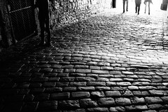 A stony way (Fuji X100S) (stefankamert) Tags: stefankamert bw sw noir noiretblanc blackandwhite blackwhite fujifilm fuji x100 x100s stony street schwarzweis people dof highlights refections