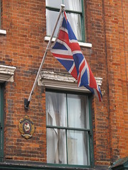 Union flag and a crest for the National Federation of Merchant Tailors. (maggie jones.) Tags: london brick flag pole