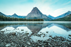 Blue Dawn (Lisa Bell Jamison) Tags: glaciernationalpark gnp twomedicine lake blue water mountains rocks trees landscape montana
