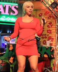 Karaoke at Cat's Meow. (Flagman00) Tags: karaoke catsmeow neworleans frenchquarter  milf gilf hotchicks hot pretty sexy women grandma mom singing stage nightlife red dress minidress legs drunk horny