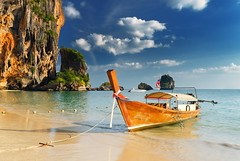 Thailand (HTML Team) Tags: color blue nobody vibrant sky holiday travel vacations summer beauty sun outdoors scene nature water transportation cloud sea turquoise tropical landscape scenics idyllic tranquil traditional clear culture bay beach coastline tourism sand nautical vessel asia thailand climate boat island destinations phuket province longtail krabi tm60026