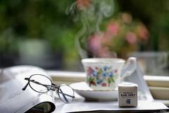 Rainy day tea (eleni m) Tags: tea rain windowsill magazines cup saucer window teabag box glasses dof bokeh vapor bonechina royalalbert vintage reflection earlgrey stilllife