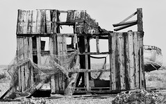 Past best. (pstone646) Tags: wreck decay hut blackandwhite monochrome beach kent dungeness building boat nets