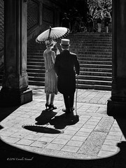 A Vision from the Past (CVerwaal) Tags: bethesdaterrace blackandwhite centralpark couples shadows umbrellas newyork ny usa fashion olympusem5 mzuiko25mmf18