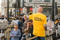 Newspaper vendor (takudzwa.mukiwa) Tags: london yellow newspaper newspapers oxford circus street photography man streetphotography