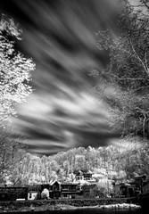 Marshall, North Carolina (Madison County) (The Photography of Ken Lane) Tags: longexposure trees usa clouds river ir town nc asheville northcarolina marshall infrared madisoncounty wnc westernnorthcarolina iray irfilter marshallnc singhray singhrayfilter marshallnorthcarolina