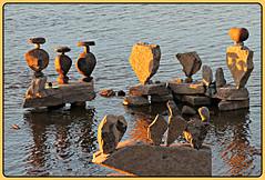 Glowing Rock Balance (bigbrowneyez) Tags: glowingrockbalance goldenhour rocks rockart beautiful fantastic striking stunning delightful fun creative clever nature natura river ottawa rivek dangerous big fabulous ottawariver canada remicrapids amazing awesome cool sunset brilliant glow glowing statues artfull art balancing frame cornice water acua reflections ripples sunny sole fume skillful masterpiece