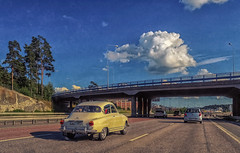 cruising the E4 (Dale Michelsohn) Tags: road bridge car canon vintage highway traffic motorway sweden stockholm saab e4 g5x dalemichelsohn