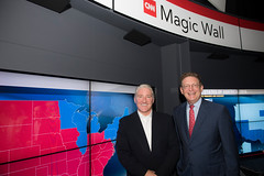 John King and Newseum CEO Jeffrey Herbst pose in front of the Magic Wall.