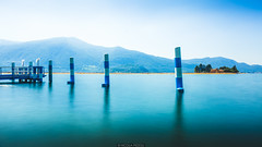 Sensole (Nicola Pezzoli) Tags: blue people italy mountain lake art tourism nature water colors yellow canon reflections island design long exposure piers floating monte bergamo brescia lombardia isola iseo sensole sulzano