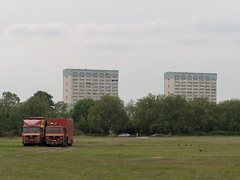 Truck Synchronicity (Magic Pea) Tags: park trees red urban green grass photography photo towers minimal flats blocks trucks simple wansteadflats magicpea