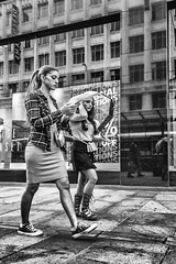 Texting is serious stuff (tootdood) Tags: street blackandwhite window mobile reflections manchester couple phone serious market candid cell stuff fromthehip texting streetcandid canon70d