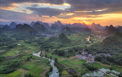 Cuiping sunset (ANOTHER DAY AT THE OFFICE) Tags: yangshuo cuiping sunset china guangxi karst landscape agriculture guide photography fields color adventure river mountain