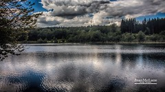 Ilay Lake. (Jean McLane) Tags: clouds cloudy nuages nubes lake lac lago reflects reflejos water trees fort forest jura ilay