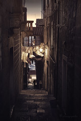 passageways of Dalmatia (cherryspicks (intermittently on/off)) Tags: korcula oldtown historic croatia architecture building house alley passageway dalmatia mediterranean adriatic cobblestone light laundryline dark dusk atmosphere mood steps