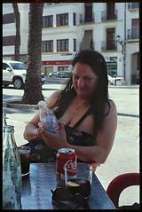 Spain 2016 - Kodak Retina Ib (Type 018 Chrome Dot) - Lisa at the 'Top Ten Tapes' Bar, Benissa (TempusVolat) Tags: holiday spainholiday spain 2016 vacance summer gareth wonfor tempus volat mrmorodo tempusvolat garethwonfor kodak retina ib vintagecamera film 35mm scan scanned scanning scanner epson perfection v200 wife lisa girl woman holidaysnaps negative beauty beautiful brunette beautifulwife beautifulwoman prettywife attractive pretty lovelywife mywife mygirl gorgeouswife lovelylisa prettylisa goodlooking goodlooks spouse lover lovely love allure elegant cleavage mole tummy belly boobs voluptuous boob breast breasts demure shapely curvy curvaceous