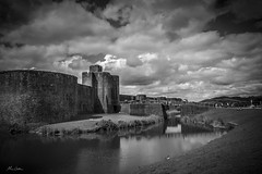 Caerphilly Castle (MikeOldhamPhotography) Tags: caerphilly castle sky water bridge blue leaning black grass fujifilm xpro 1 18mm photography mike oldham wales uk clouds